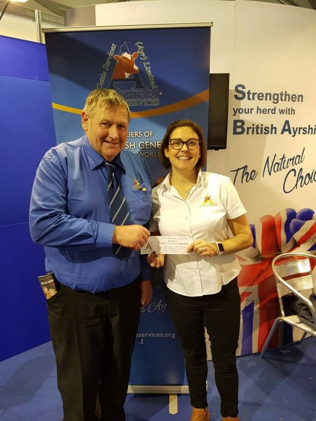 Pictured is Society President Philip Williams and Ayrshire General Manager Claire Kimm, with the winning entry from the prize draw.