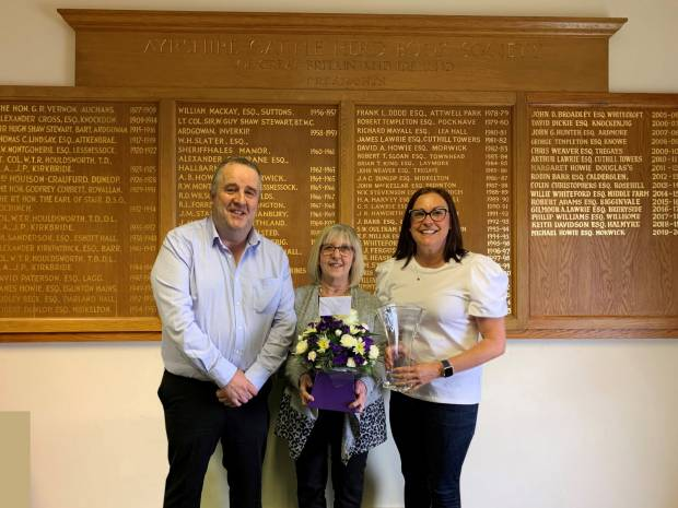 Gilmour Lawrie, Business Coordinator and Claire Kimm, General Manager present Lesley with her retirement gifts.