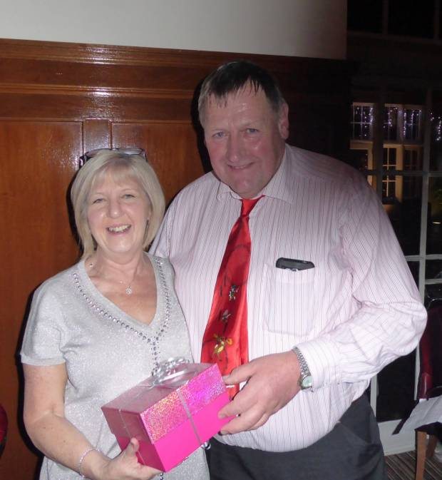 President Philip Williams presenting Lesley with a gift to recognise her service.
