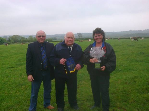 Right to left - Lisa Window-Walker and her late father Chris Window being presented with the Haresfoot Vase by Alan Timbrell