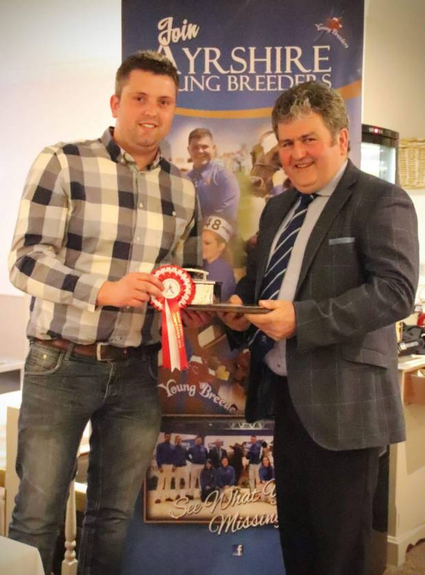 Stockjudging and Sire Selection senior winner Asher Bradley Seddon with Society President Keith Davidson