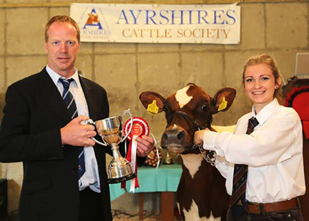Champion handler, and winner of the mature showmanship class was Sarah Jones, Ballymena. Presenting the trophy is judge Peter Berresford. Picture by Jane Steel.