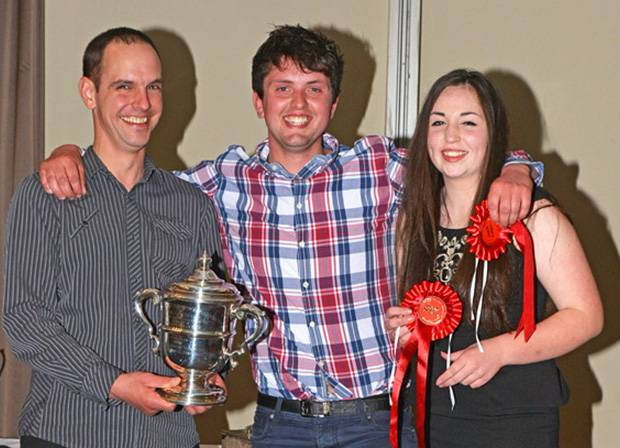 Darland Trophy Winners - Asher Bradley Seddon (middle) and Evie Tomlinson receiving their trophy from Michael Broadley