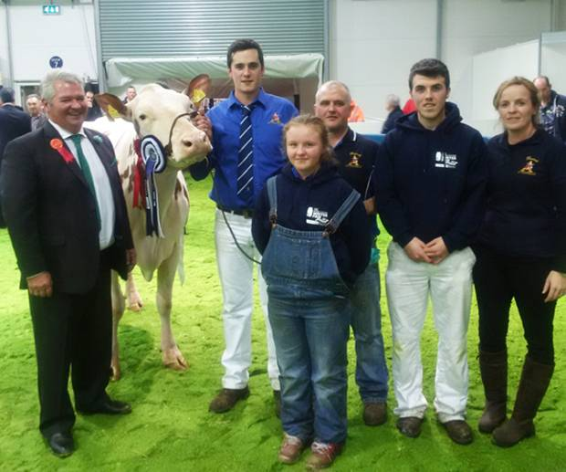 Judge - Selwyn Donald (left) with the Keenan family and their champion Ayrshire